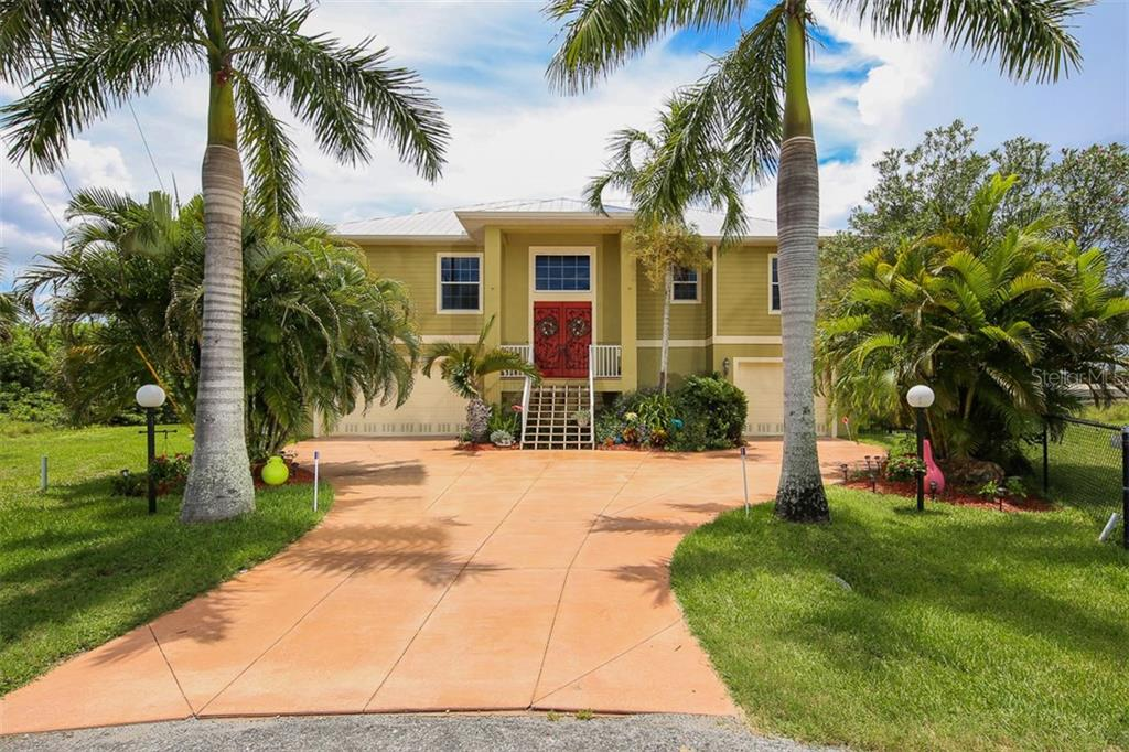 Come right in and experience this one-of-a-kind waterfront home - and fall in love! - Single Family Home for sale at 17296 Foremost Ln, Port Charlotte, FL 33948 - MLS Number is C7240998