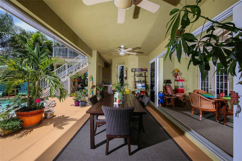 Large covered lanai area for outdoor entertaining - enjoy your morning coffee or evening libation! - Single Family Home for sale at 17296 Foremost Ln, Port Charlotte, FL 33948 - MLS Number is C7240998
