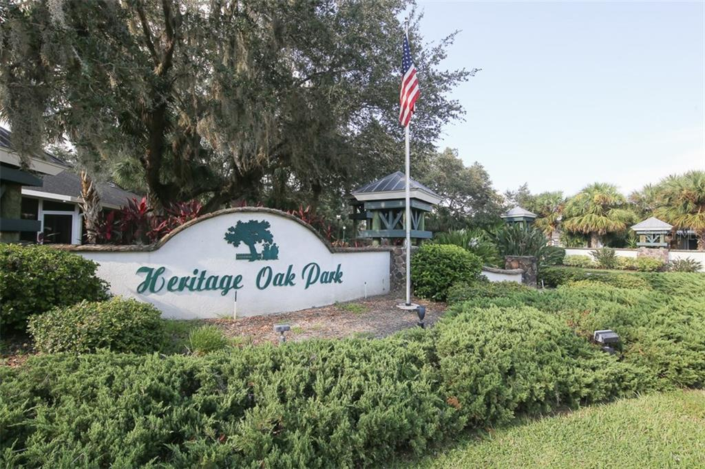 Entry to Heritage Oak Park is lined with gorgeous Oak trees creating a magnificent canopy as you enter - Villa for sale at 1234 Green Oak Trl, Port Charlotte, FL 33948 - MLS Number is C7243720