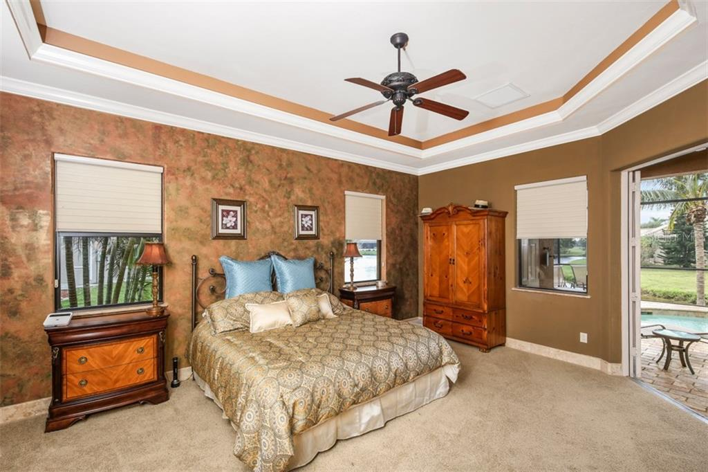 The Master Suite enjoys pool views through double French doors, generous natural lighting, ensuite bath, and dual California closets. - Single Family Home for sale at 17208 Barcrest Ln, Punta Gorda, FL 33955 - MLS Number is C7245458