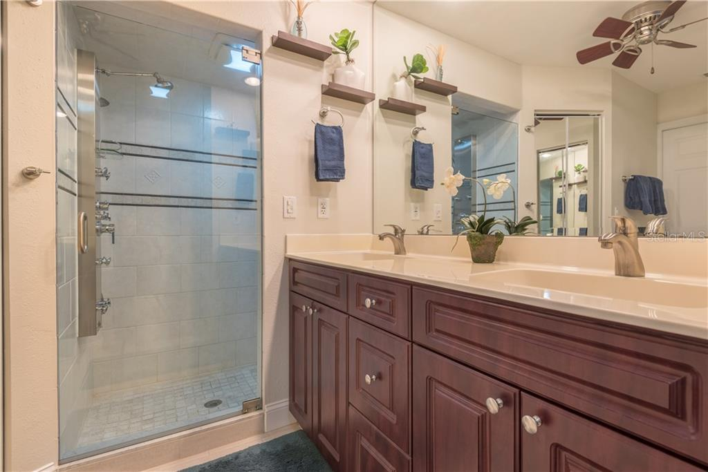 Master bathroom. Notice the shower with the multiple spray jets and the large vanity with dual sinks. - Single Family Home for sale at 2510 Rio Largo Ct, Punta Gorda, FL 33950 - MLS Number is C7246934
