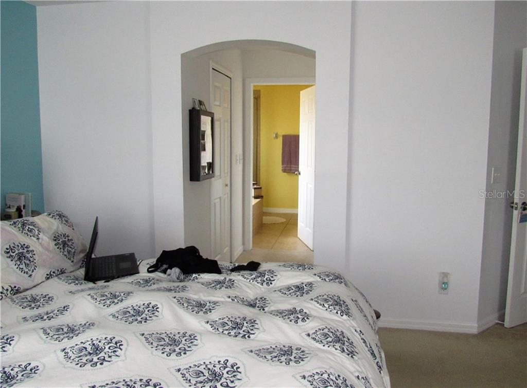 Master bedroom with a view of the master bath - Single Family Home for sale at 24041 Canal St, Port Charlotte, FL 33980 - MLS Number is C7400879