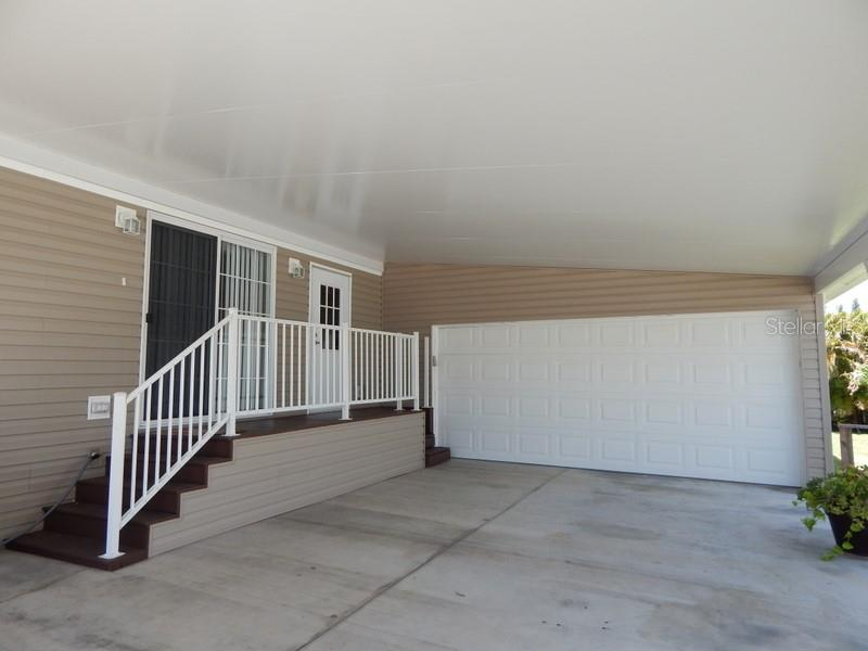 Extra deep 2-car garage - Manufactured Home for sale at 11 Holland Ave, Punta Gorda, FL 33950 - MLS Number is C7401035