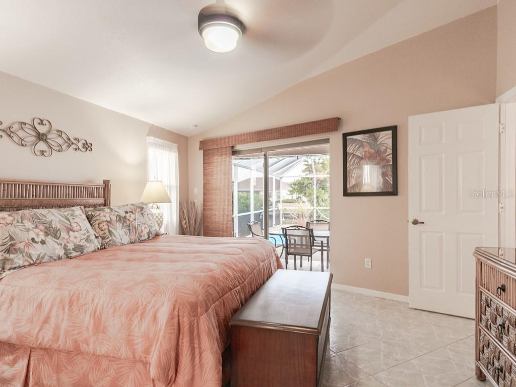 Master suite has a slider that opens to the lanai - Single Family Home for sale at 15464 Avery Rd, Port Charlotte, FL 33981 - MLS Number is C7401914