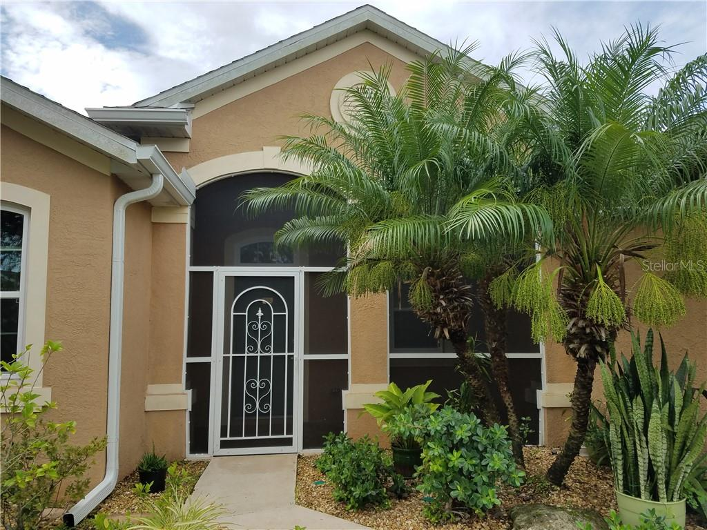 Mature lush landscaping welcomes you at the front door. - Single Family Home for sale at 2752 Suncoast Lakes Blvd, Punta Gorda, FL 33980 - MLS Number is C7402671