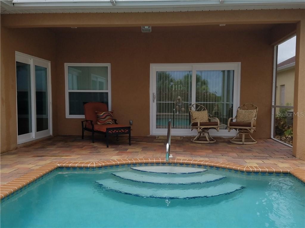 Gradual stairs and handrail provides safe access for family & friends of all ages. - Single Family Home for sale at 2752 Suncoast Lakes Blvd, Punta Gorda, FL 33980 - MLS Number is C7402671