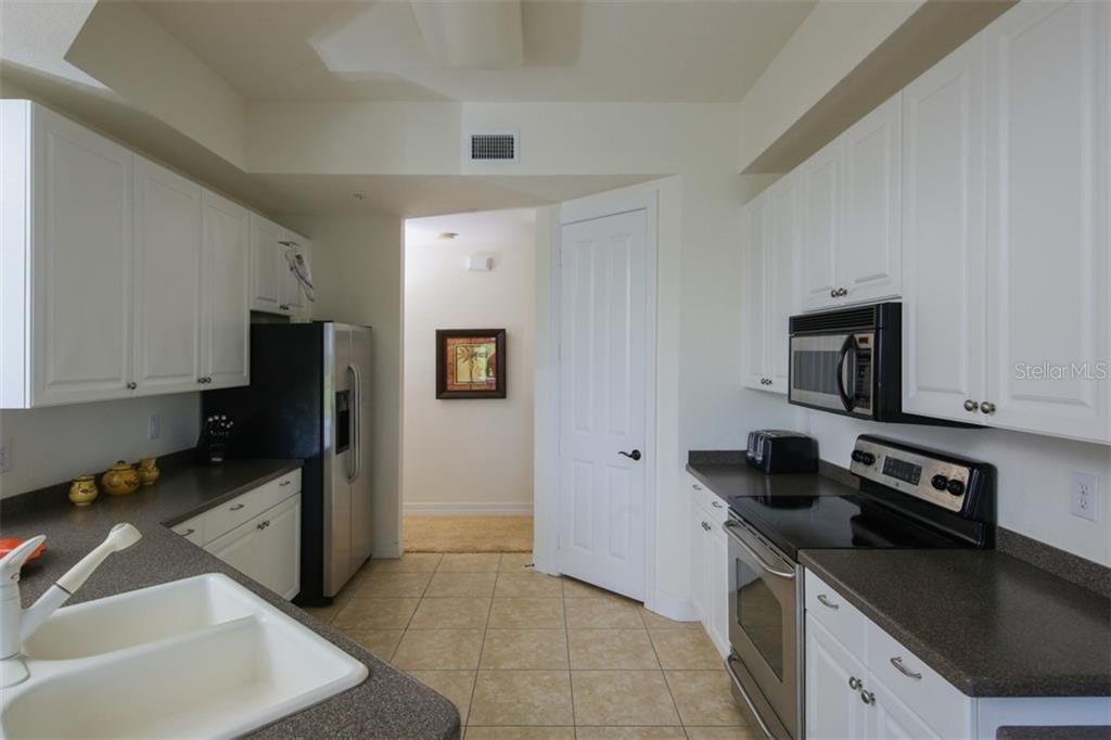 Kitchen - Condo for sale at 95 Vivante Blvd #303, Punta Gorda, FL 33950 - MLS Number is C7402746