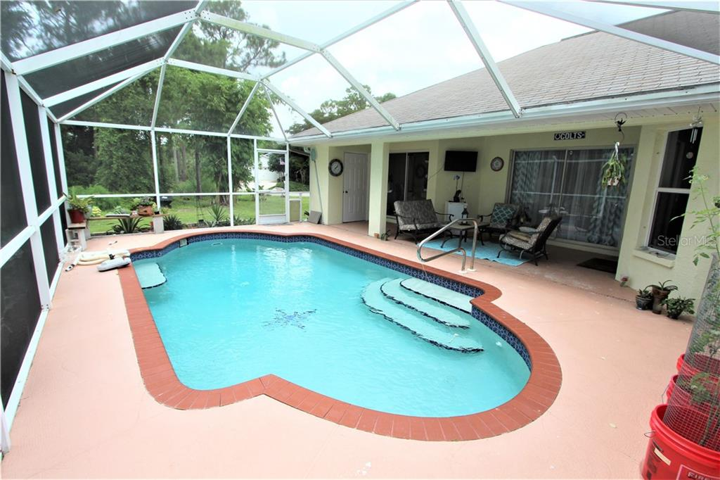 Pool & Lanai - Single Family Home for sale at 4846 Weatherton St, North Port, FL 34288 - MLS Number is C7403500