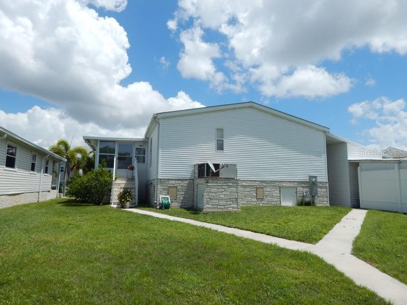 Rear of home - Manufactured Home for sale at 66 Windmill Blvd, Punta Gorda, FL 33950 - MLS Number is C7405183
