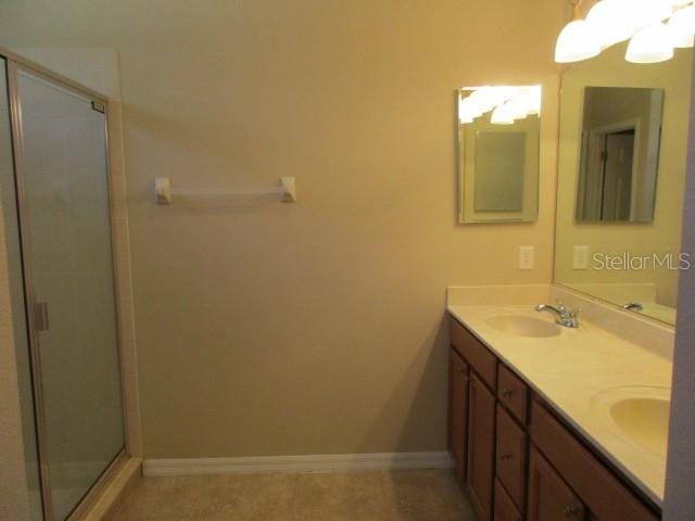 EN SUITE WITH DUAL SINKS AND TILED SHOWER - Villa for sale at 1486 Maseno Dr, Venice, FL 34292 - MLS Number is C7405922