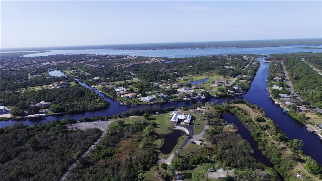Overhead view of the property and Myakka River. - Single Family Home for sale at 1289 Casper St, Port Charlotte, FL 33953 - MLS Number is C7407177