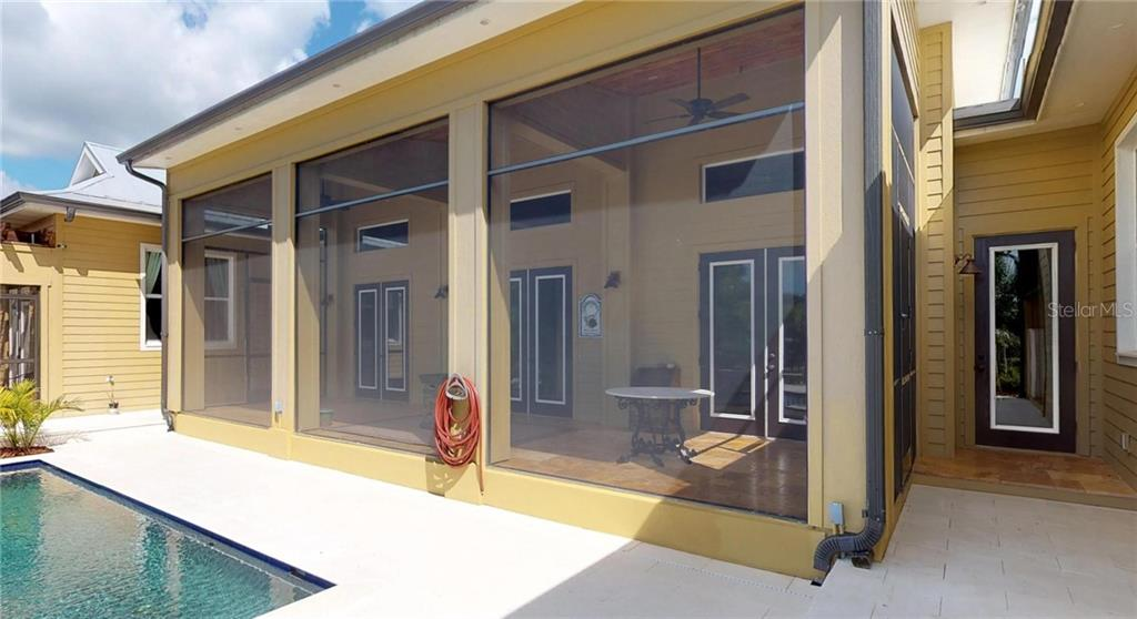 One of 3 patio areas overlooking the pool with White Travertine Tile from Turkey - Single Family Home for sale at 1289 Casper St, Port Charlotte, FL 33953 - MLS Number is C7407177
