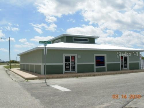 commercial building behind property - Vacant Land for sale at 3084 Foley Dr, Punta Gorda, FL 33983 - MLS Number is C7407681