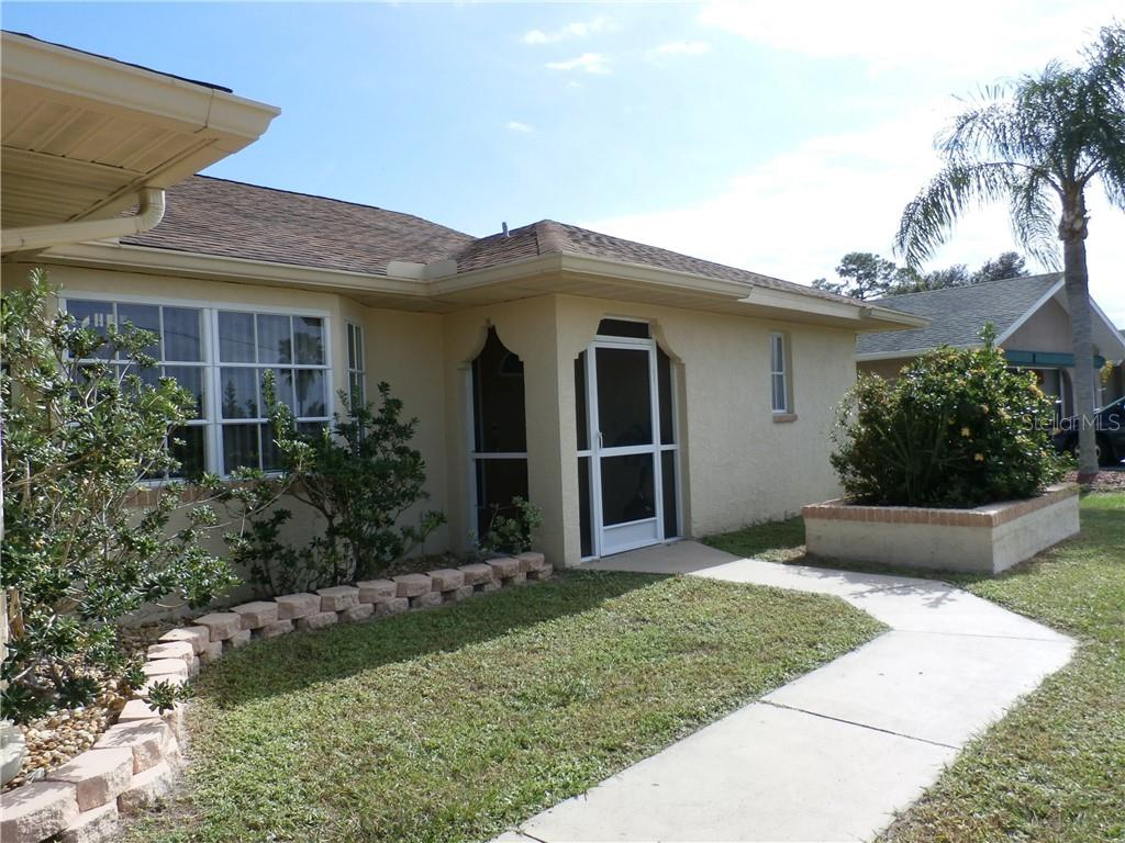 Front walkway - Single Family Home for sale at 416 Bahia Grande Ave, Punta Gorda, FL 33983 - MLS Number is C7408301