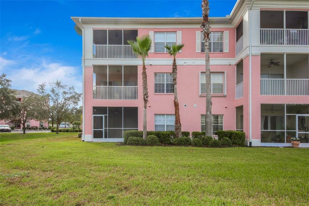 Rear of unit with screen porch & double windows in Master Bedroom. - Condo for sale at 2040 Willow Hammock Cir #b208, Punta Gorda, FL 33983 - MLS Number is C7408424
