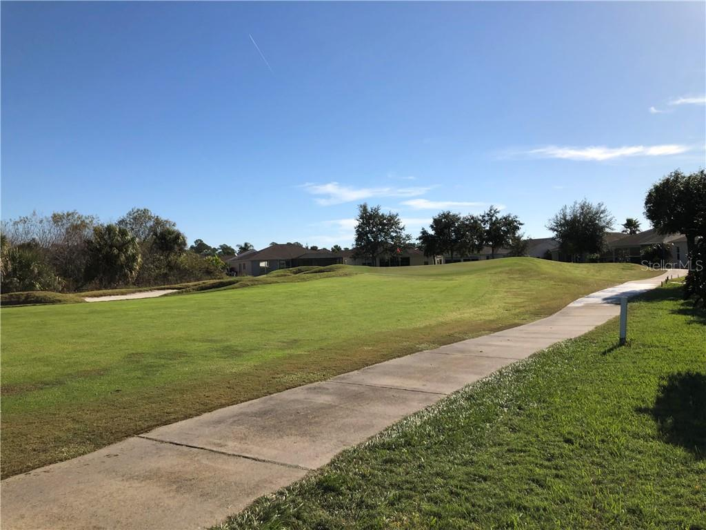 Backyard view of 12th Fairway - Single Family Home for sale at 24380 Westgate Blvd, Port Charlotte, FL 33980 - MLS Number is C7408906