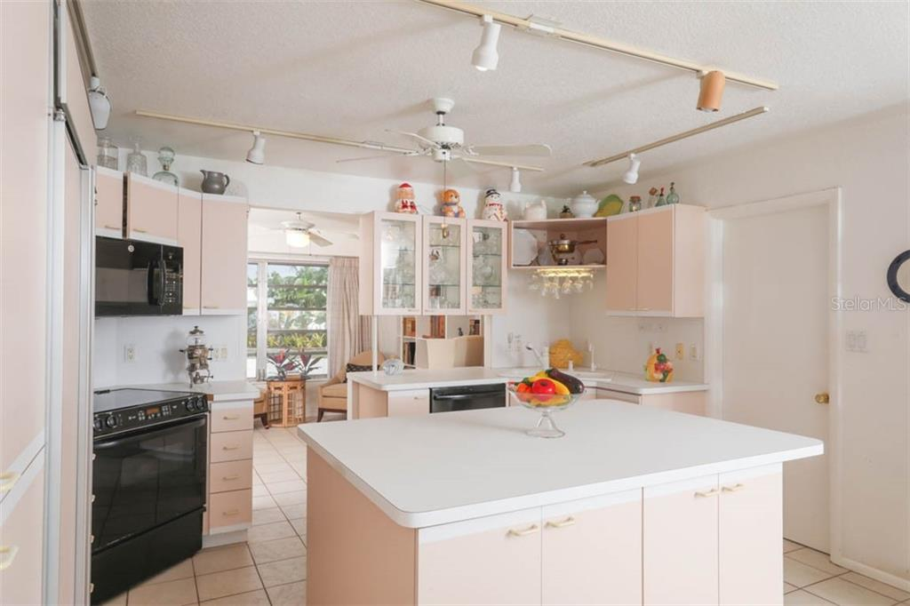Stepping into the Kitchen looking to front & library. - Single Family Home for sale at 2291 Bayview Rd, Punta Gorda, FL 33950 - MLS Number is C7409445