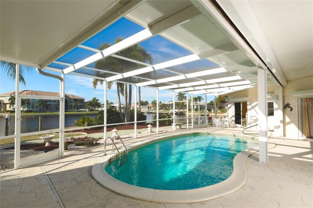 Pool toward BR 2 & 3- surrounded by water views. - Single Family Home for sale at 2291 Bayview Rd, Punta Gorda, FL 33950 - MLS Number is C7409445