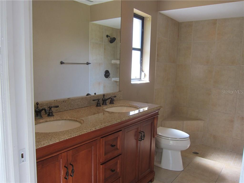 Master bath with dual sinks and walk in shower - Single Family Home for sale at 1170 Richter St, Port Charlotte, FL 33952 - MLS Number is C7411803