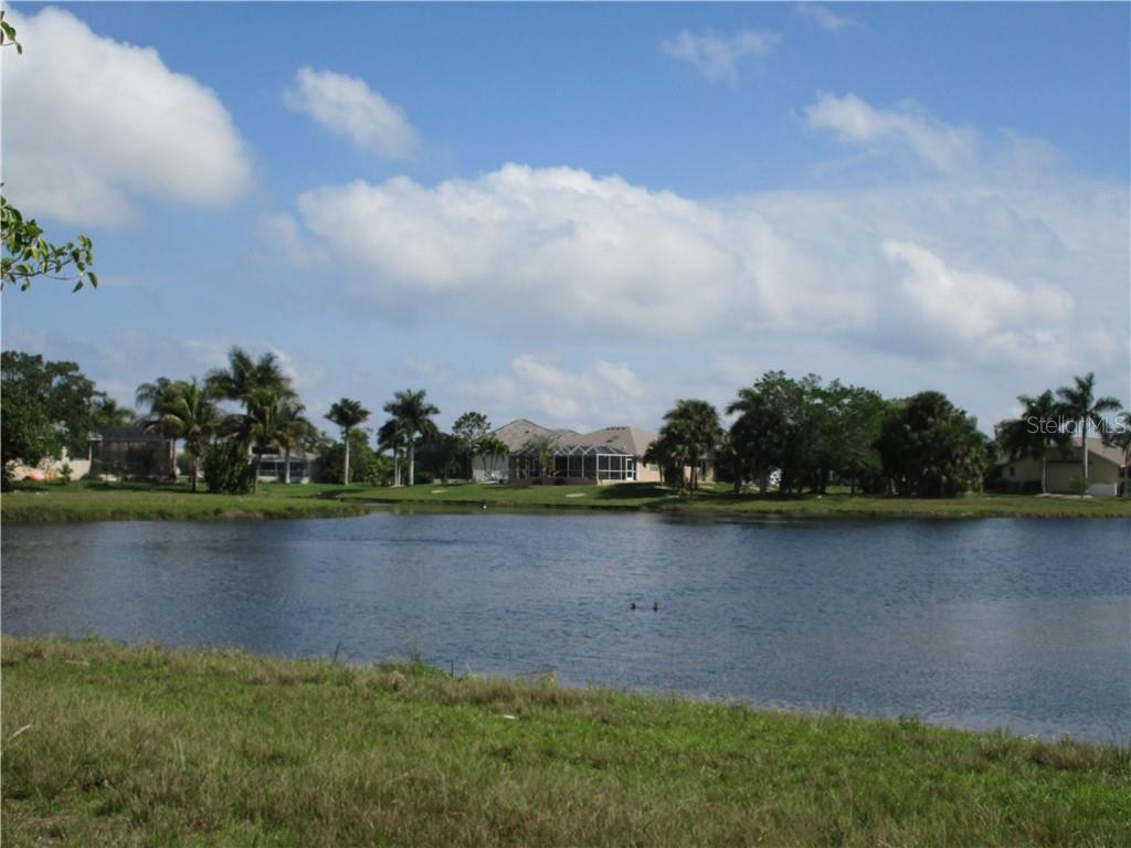 lakefront living with lovely homes in a tropcal setting - Vacant Land for sale at 16308 Cayman Ln, Punta Gorda, FL 33955 - MLS Number is C7413152