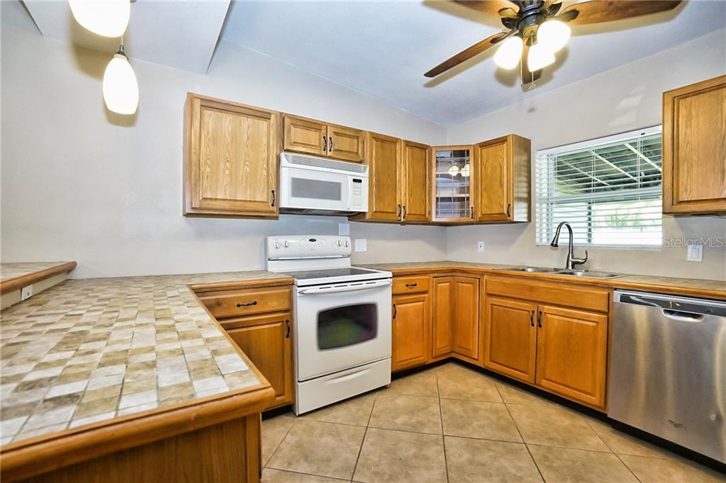 Kitchen - Wood Cabinets - Single Family Home for sale at 3513 Areca St, Punta Gorda, FL 33950 - MLS Number is C7414620