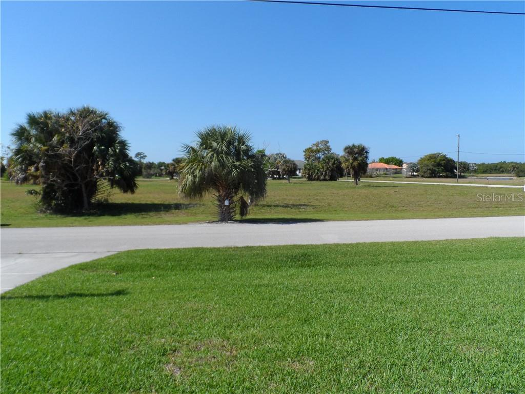 View from front door across the street - Single Family Home for sale at 24126 Santa Inez Rd, Punta Gorda, FL 33955 - MLS Number is C7416081