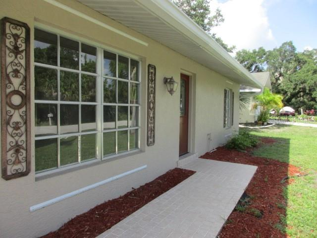 CLOSE UP WALKWAY AND FRONT - Single Family Home for sale at 925 Tropical Ave Nw, Port Charlotte, FL 33948 - MLS Number is C7417107