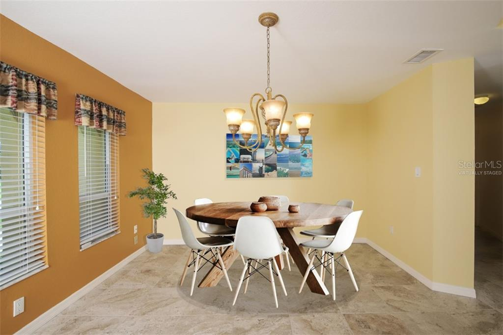 virtually staged Dining Area from Living towards entry doors - Single Family Home for sale at 2713 Saint Thomas Dr, Punta Gorda, FL 33950 - MLS Number is C7417491