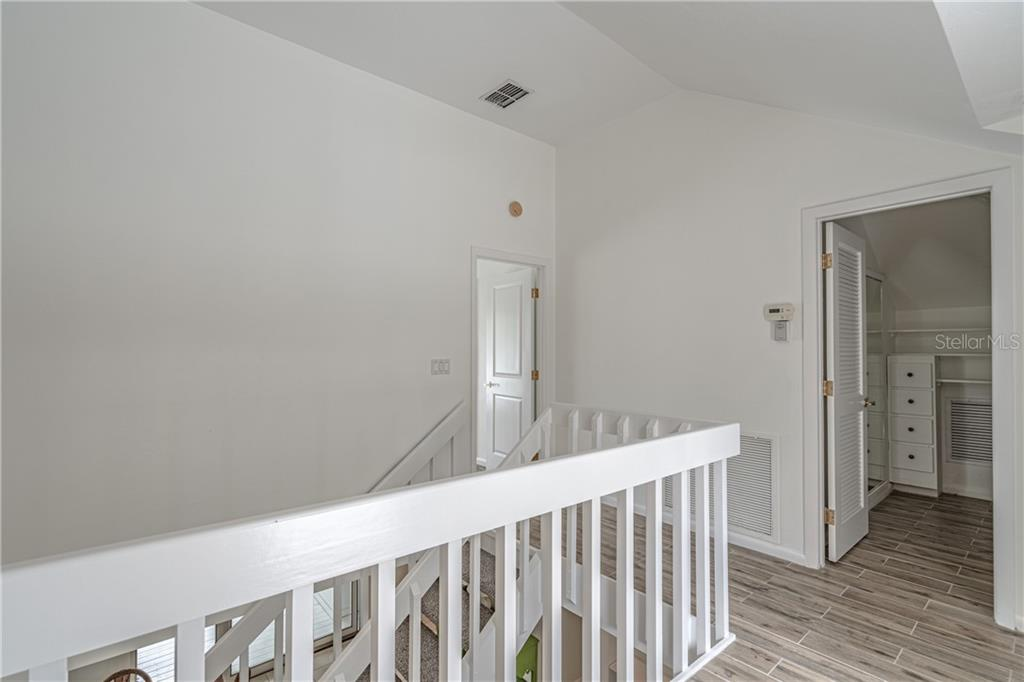 Stairway to upper level master with 2 walk in closets and 2 balconies - one on each side of the home - Single Family Home for sale at 124 Useppa Is, Captiva, FL 33924 - MLS Number is C7419408