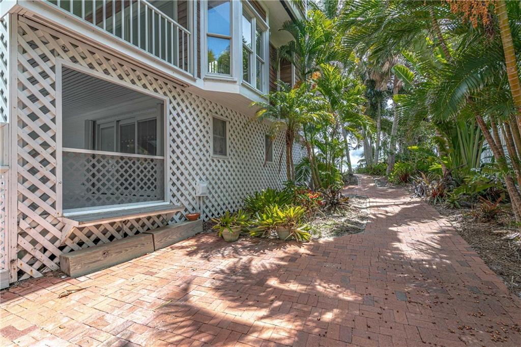 pathway beside the home - Single Family Home for sale at 124 Useppa Is, Captiva, FL 33924 - MLS Number is C7419408