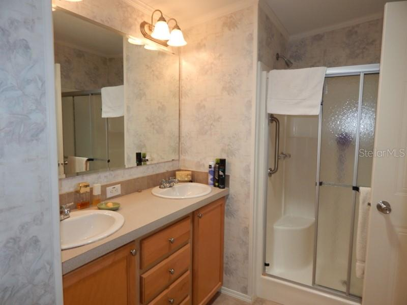 Master bath with step-in shower, dual sink vanity - Manufactured Home for sale at 31 Freeman Ave, Punta Gorda, FL 33950 - MLS Number is C7420702