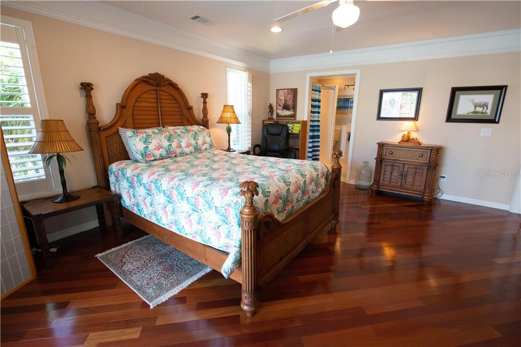 Spacious master bedroom with updated ensuite bath.  Huge walk-in closet (hers) and another closet (his) provide abundant storage. Newly tiled roll-in accessible shower. - Single Family Home for sale at 1440 Appian Dr, Punta Gorda, FL 33950 - MLS Number is C7425399