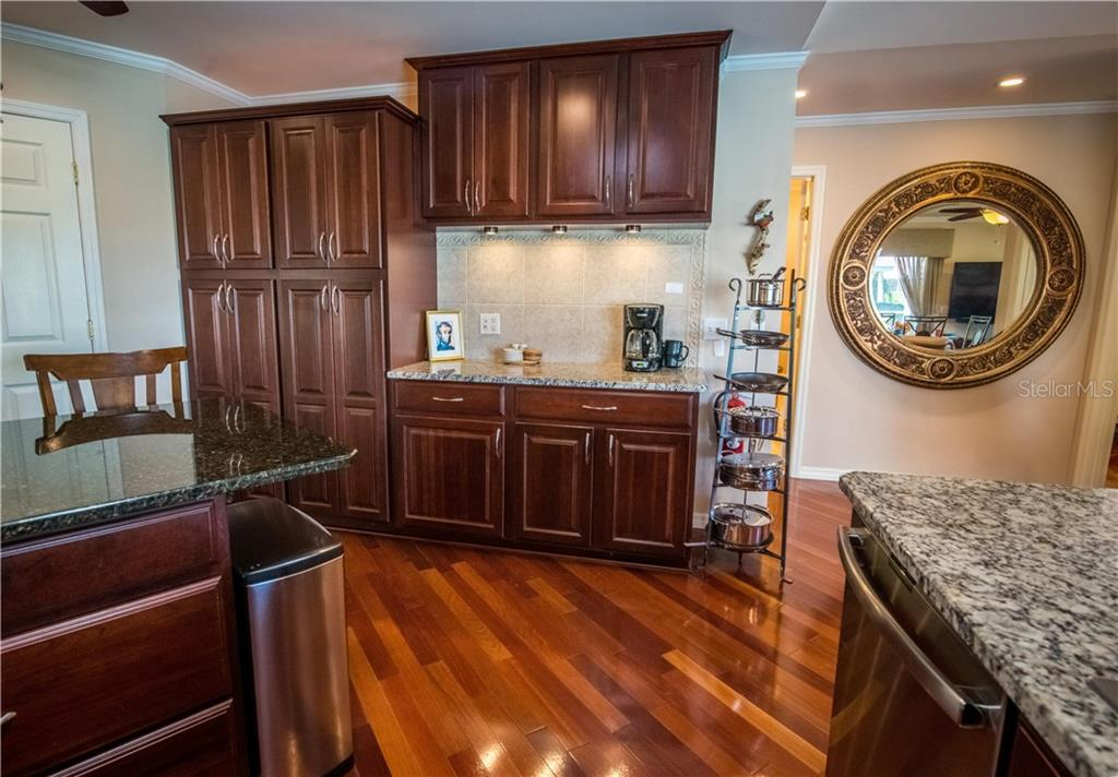 Pull-outs in cabinets make for convenient storage. Soft-close cabinets and drawers. - Single Family Home for sale at 1440 Appian Dr, Punta Gorda, FL 33950 - MLS Number is C7425399