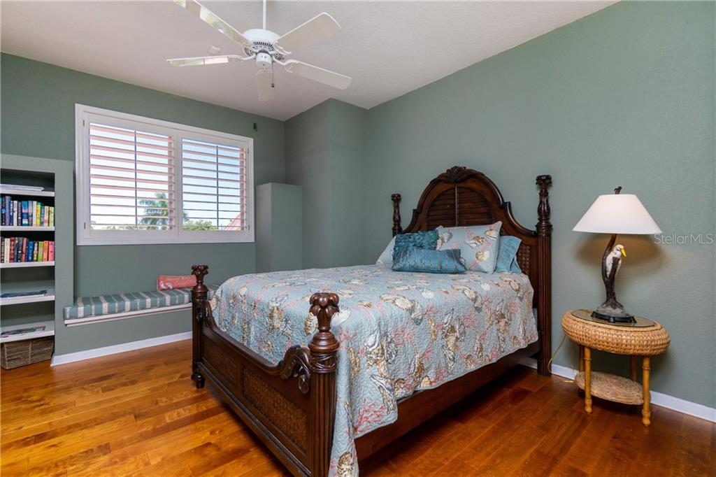 BEDROOM #4 WITH HARDWOOD FLOORS, WINDOW SEAT AND PLANTATION SHUTTERS - Single Family Home for sale at 3537 Caya Largo Ct, Punta Gorda, FL 33950 - MLS Number is C7431664