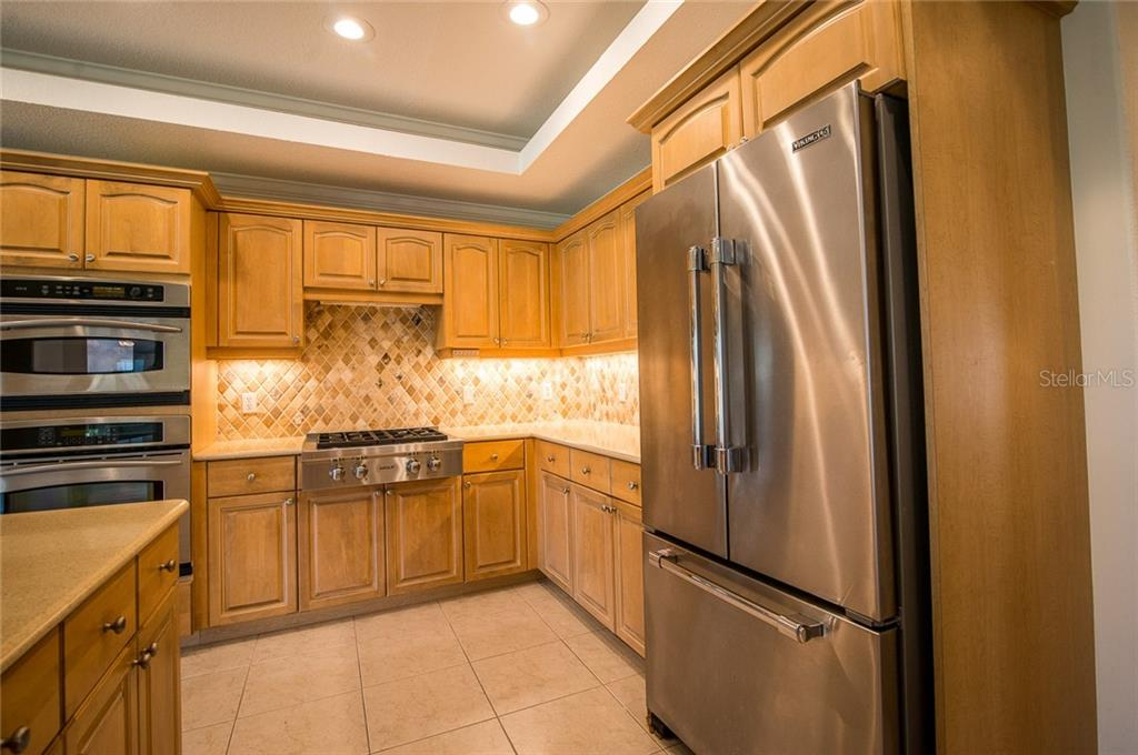Enjoy luxury-grade appliances like the Wolf gas stove and Viking refrigerator and dishwasher. - Condo for sale at 4410 Warren Ave #511, Port Charlotte, FL 33953 - MLS Number is C7432222
