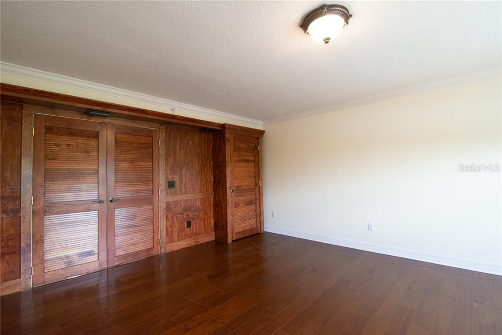 Opposite the wall with the picture window, are the double entry doors and storage closet. Warm and functional, you will find many uses for this large room. - Condo for sale at 4410 Warren Ave #511, Port Charlotte, FL 33953 - MLS Number is C7432222