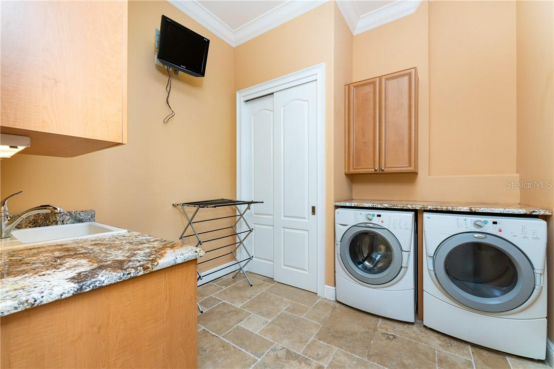 Two laundry rooms for convenience. This one on the second floor - Single Family Home for sale at 7440 Riverside Dr, Punta Gorda, FL 33982 - MLS Number is C7436263