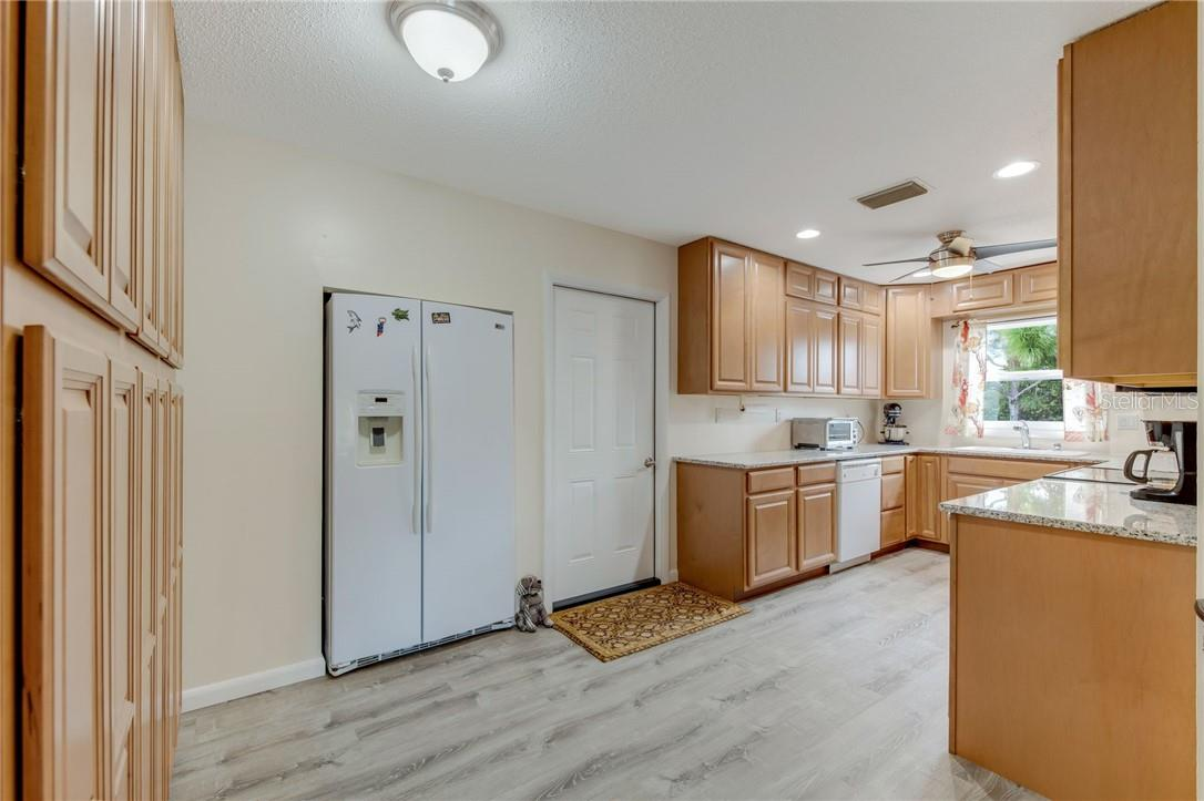 Love to cook? You'll have plenty of counter space, work areas, and a wall of pantry storage! - Single Family Home for sale at 24368 Blackbeard Blvd, Punta Gorda, FL 33955 - MLS Number is C7436898