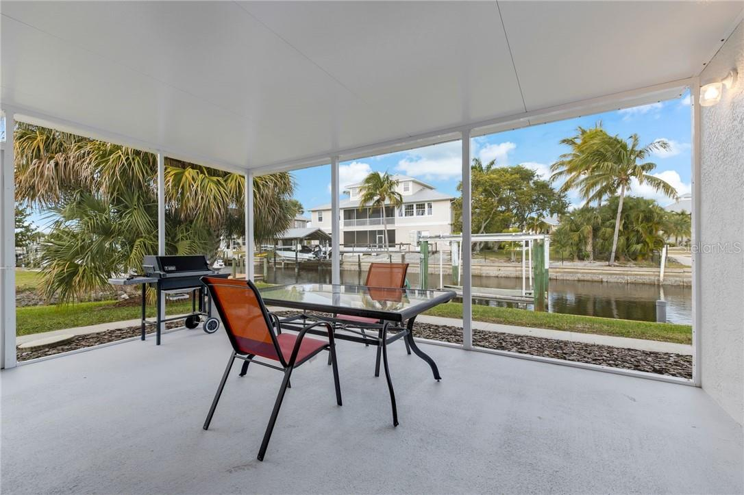 Brand new 15'x18' lanai with floor to ceiling screens. No cross struts! Where you'll spend your days and nights! - Single Family Home for sale at 24368 Blackbeard Blvd, Punta Gorda, FL 33955 - MLS Number is C7436898