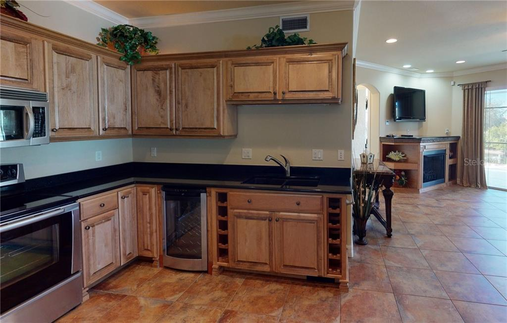 1st floor kitchen with wine cooler. - Single Family Home for sale at 4245 Spire St, Port Charlotte, FL 33981 - MLS Number is C7437570