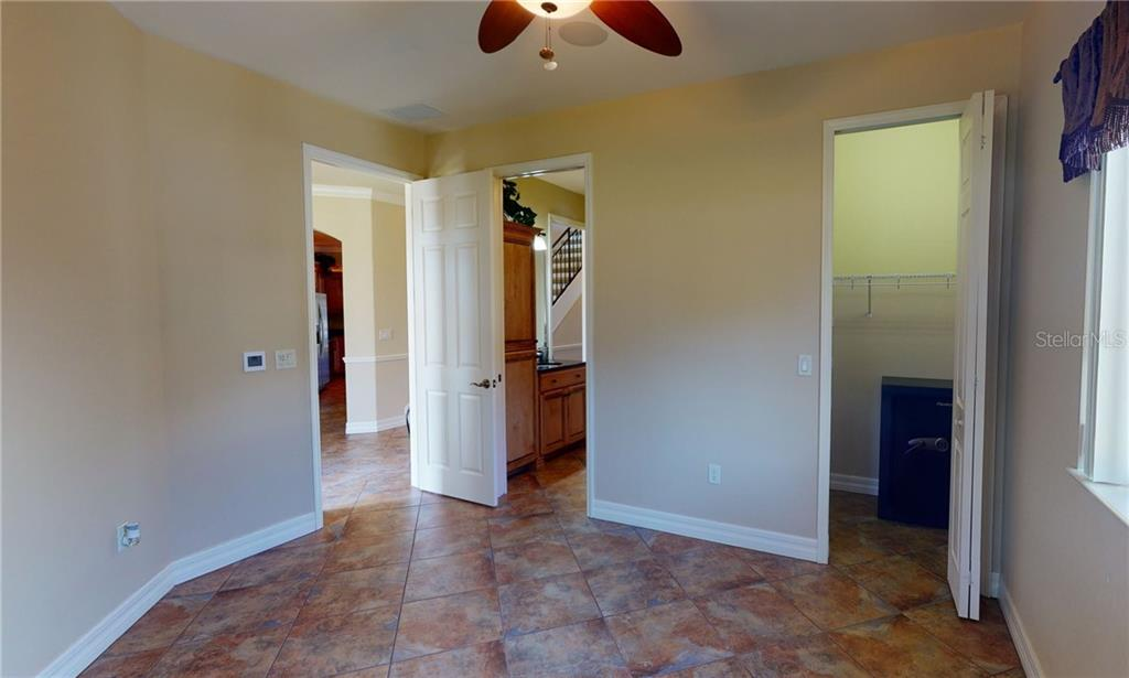 1st floor with guest bedroom with walk-in closet. - Single Family Home for sale at 4245 Spire St, Port Charlotte, FL 33981 - MLS Number is C7437570