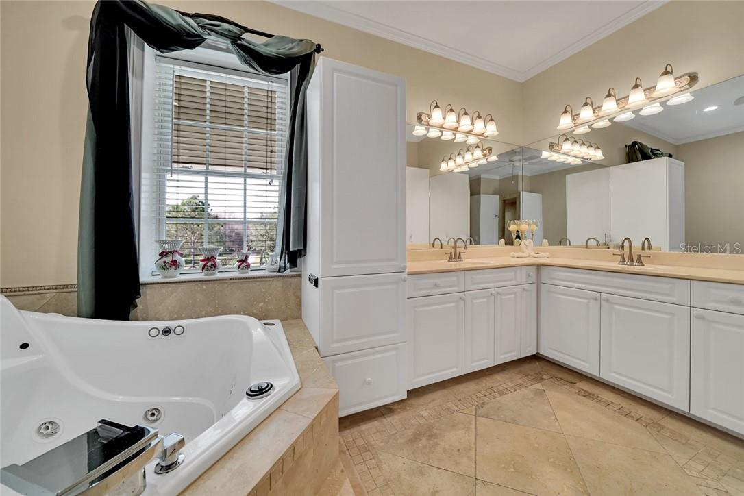 Master bathroom, cabinet linen closet - Single Family Home for sale at 10230 Sw County Road 769, Arcadia, FL 34269 - MLS Number is C7437596