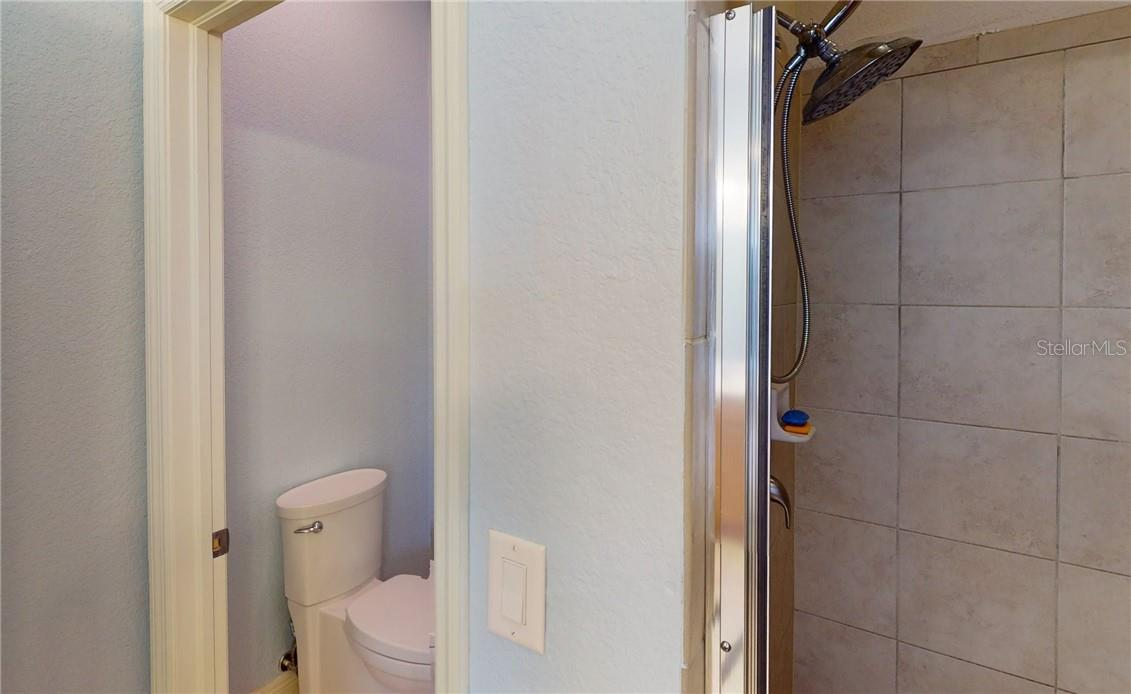 Master bath shower and water closet. - Single Family Home for sale at 11905 Florence Ave, Port Charlotte, FL 33981 - MLS Number is C7441003