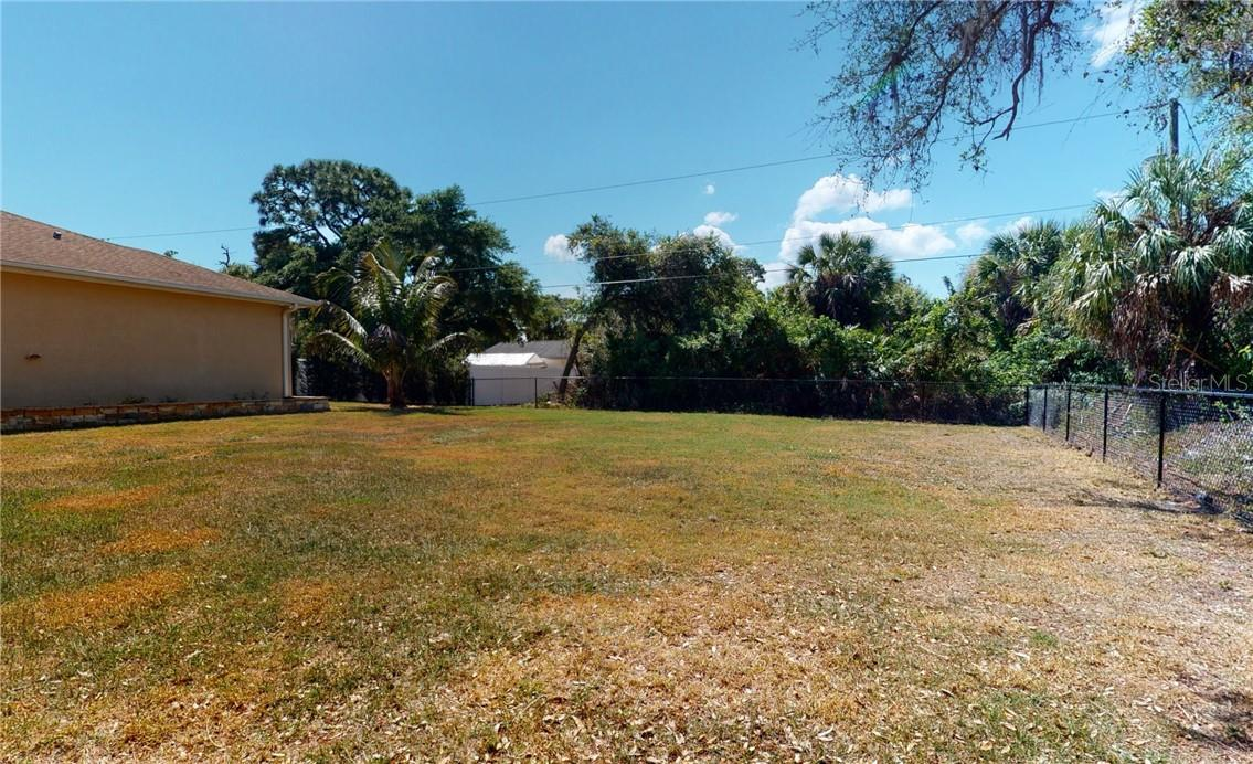 Different view of extra fenced lot. - Single Family Home for sale at 11905 Florence Ave, Port Charlotte, FL 33981 - MLS Number is C7441003