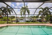 Simply bask in this beautiful view when swimming in this large pool - Single Family Home for sale at 1620 Appian Dr, Punta Gorda, FL 33950 - MLS Number is C7242315