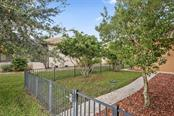 This fenced area runs along the western side of the home and is a great playgournd for your four legged best friend! - Single Family Home for sale at 17208 Barcrest Ln, Punta Gorda, FL 33955 - MLS Number is C7245458