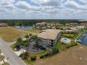 Condo for sale at 1349 Aqui Esta Dr #136, Punta Gorda, FL 33950 - MLS Number is C7400245