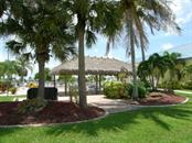 Luau at the Tiki Hut! - Manufactured Home for sale at 11 Holland Ave, Punta Gorda, FL 33950 - MLS Number is C7401035