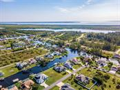 CANAL AVERAGES 16 FEET DEEP. THE LOCK CONTROLS THE WATER LEVEL AT ALL TIMES. MINUTES TO THE GULF FOR WORLD CLASS FISHING AND MORE! - Single Family Home for sale at 15464 Avery Rd, Port Charlotte, FL 33981 - MLS Number is C7401914