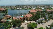 Front of 3 building clubhouse with amenities you will not find elsewhere - Condo for sale at 95 Vivante Blvd #303, Punta Gorda, FL 33950 - MLS Number is C7402746